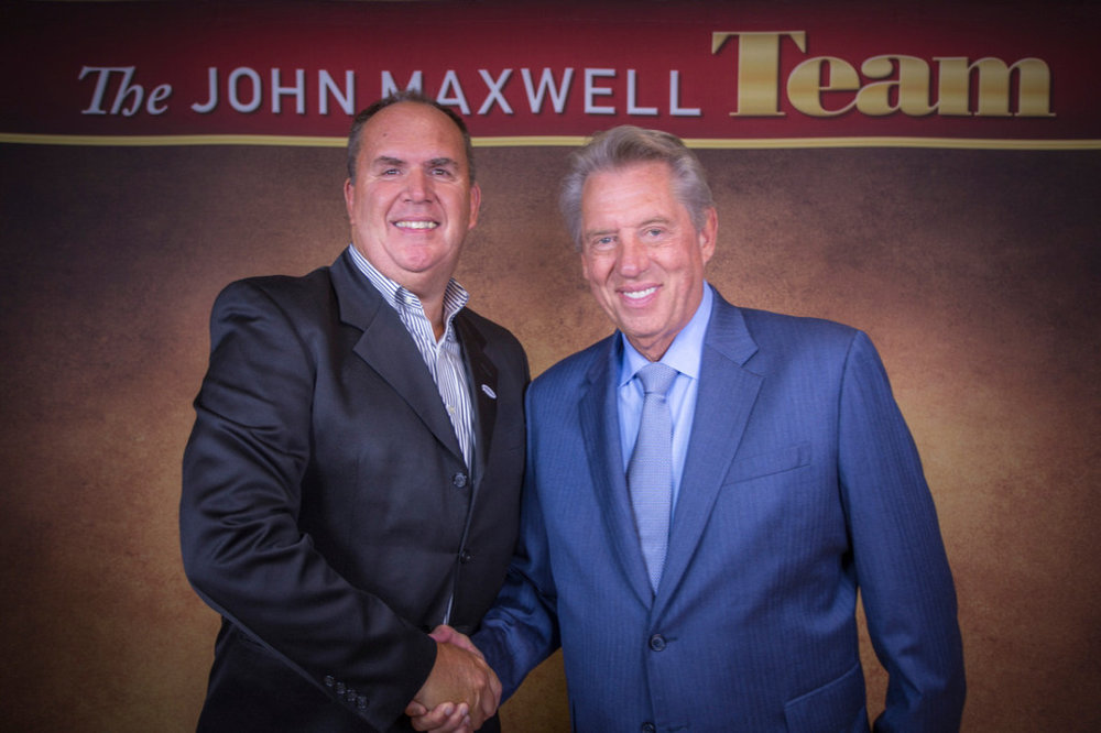 Jeff Raver, Begin to Win President, with his own personal coach and mentor John Maxwell.