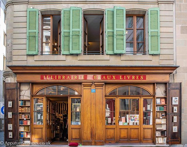 Walking in Geneva and I came across this gem of a book shop. I liked the cushion and the ashtray that matched the shutters left outside for staff taking five minutes to nip out for a quick sit down and a smoke.