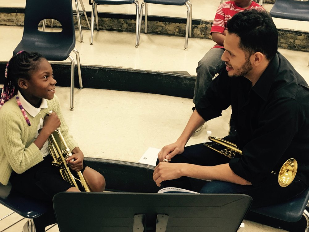 Brass Instructor Felipe Brito working with one of his students at Franklin D.Roosevelt Elementary
