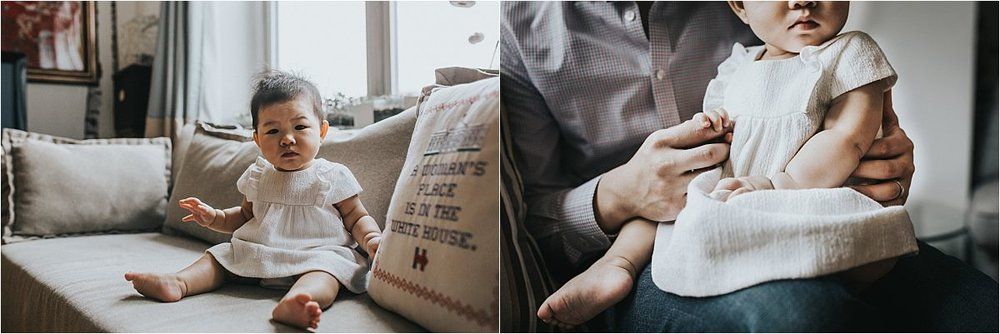 nyc family and newborn photographer baby girl sits upright on couch next to decorative couch pillow