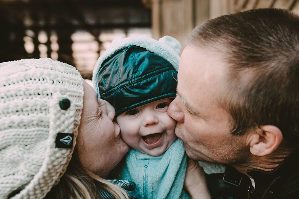 nyc newborn and family photographer dad, mom and baby in central park group hug