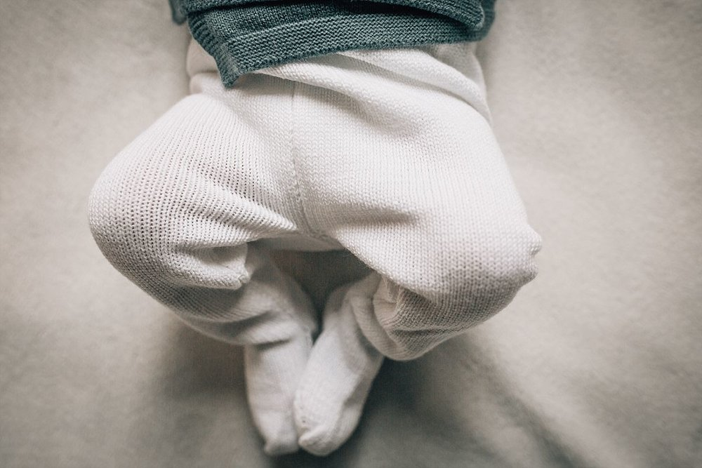 nyc family and newborn photographer newborn legs in knitted wool pants