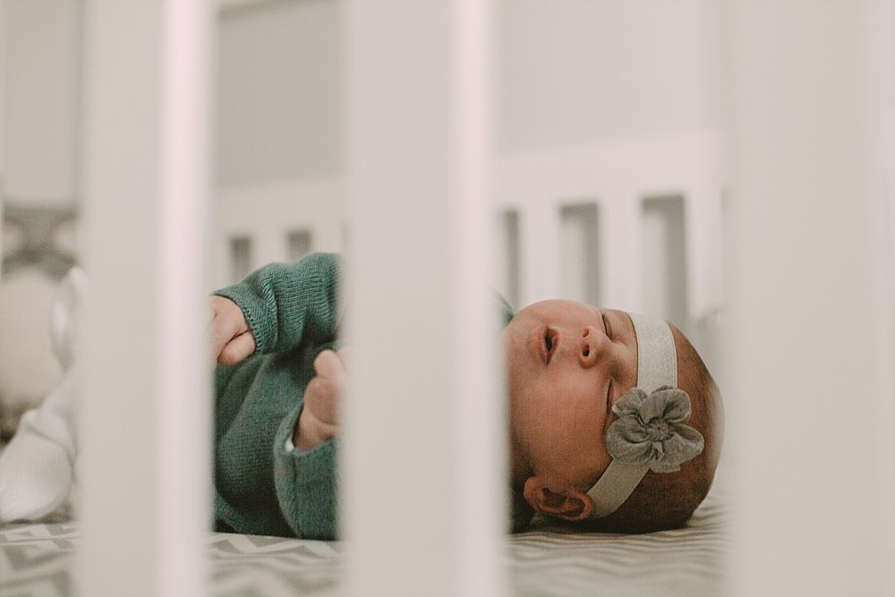 nyc family and newborn photographer newborn in crib in wool outfit
