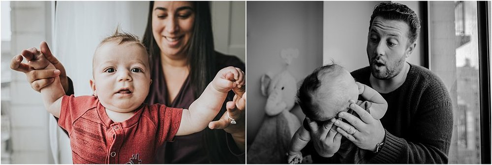 nyc family and newborn photographer mom and dad with three month old newborn baby boy in red onesie