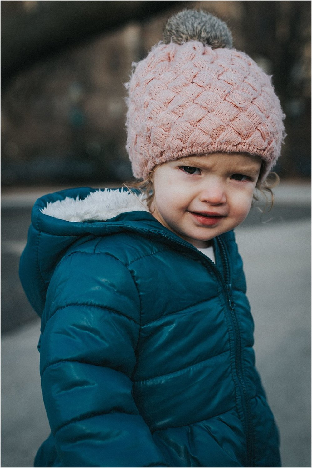 nyc family and newborn photographer close up of toddler in beanie in nyc park on the upper west side