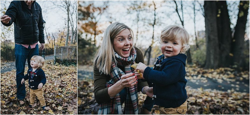nyc family and newborn photographer dad shows toddler fall leaves in nyc park