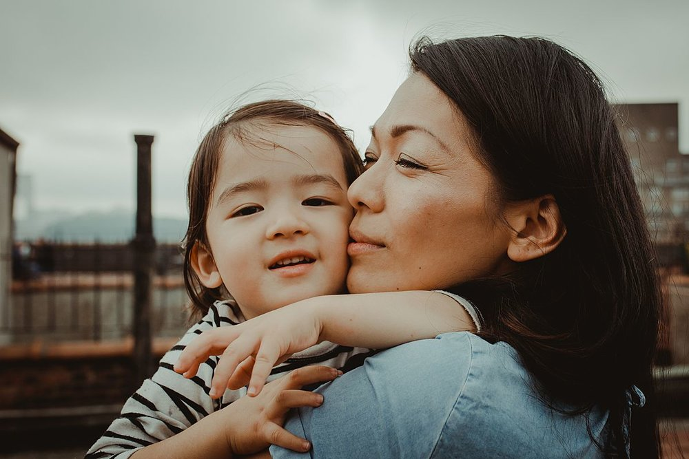 beautiful portrait of mom and her gorgeous Japanese daughter. photo taken on sunny afternoon during documentary family lifestyle session using natural light