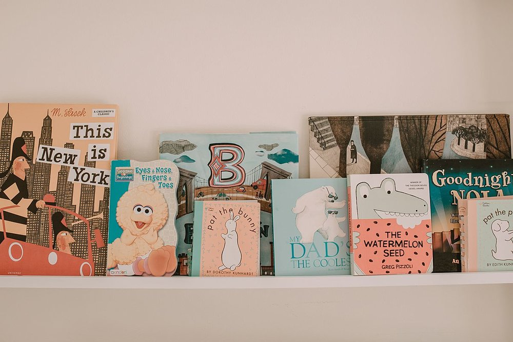 newborn details in baby room. fun and colorful kids books. image by krystil mcdowall photography