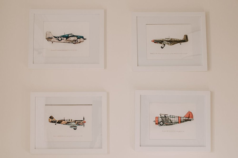baby room details with aeroplanes on the pictures on the wall