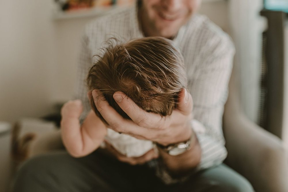 close up of dad  holding newborn daughter during nyc newborn session with krystil mcdowall photography