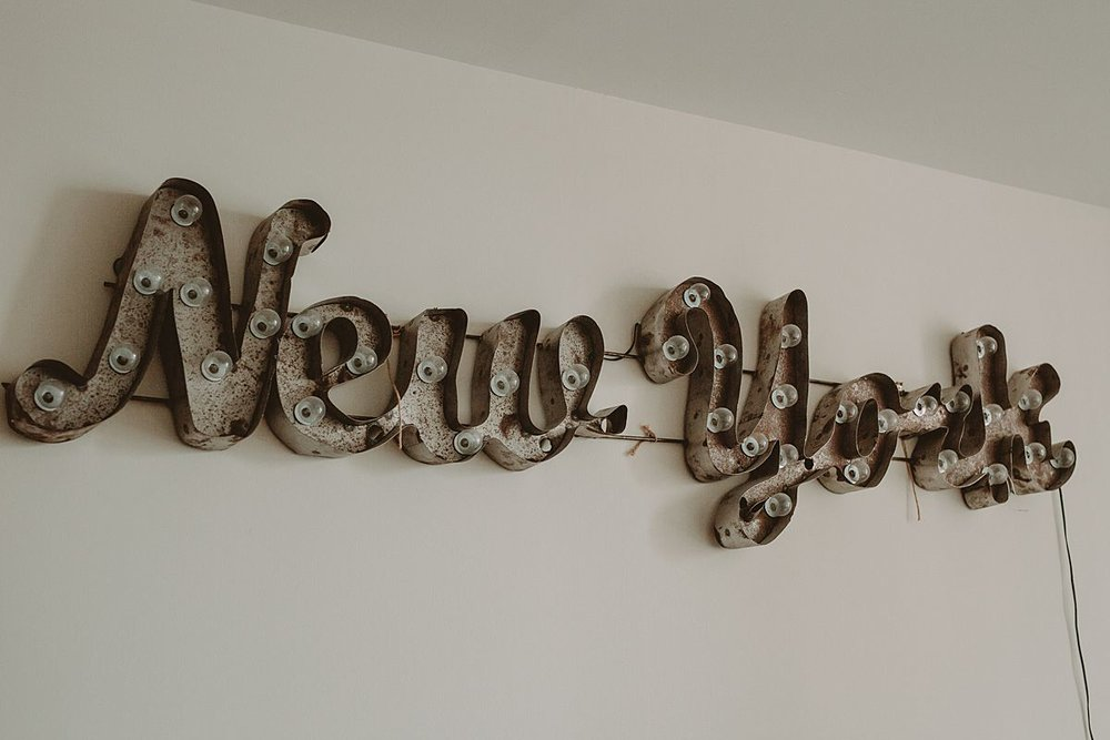 details photo of new york sign in downtown manhattan apartment. photo by nyc family and newborn photographer krystil mcdowall