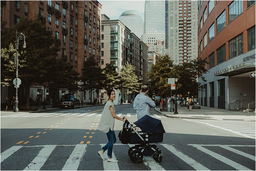 mom, dad and son take a stroll on the streets of downtown manhattan in new york city. image by nyc family and newborn photographer krystil mcdowall