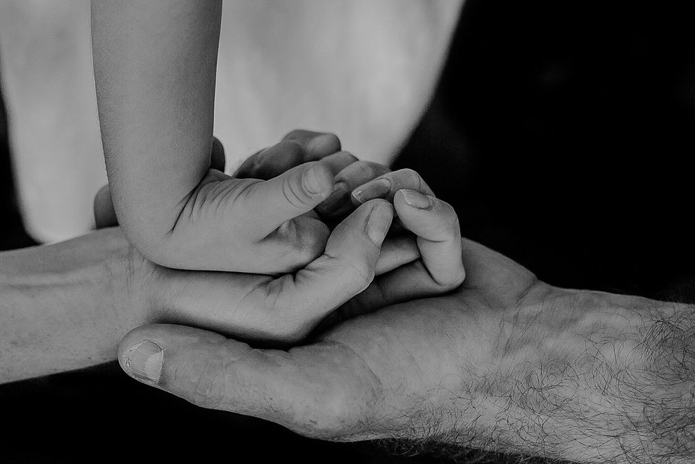 close up of dad, mom and daughter's hands. photo by nyc family and newborn photographer krystil mcdowall
