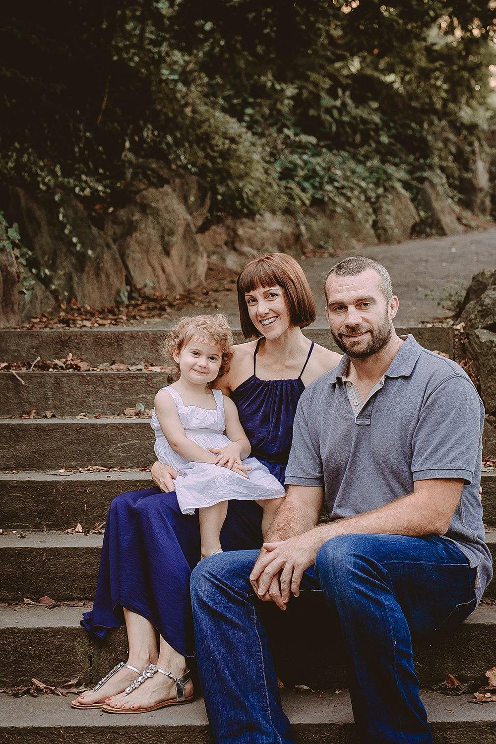 family portrait on stairs in fort tryon park during family lifestyle session. image by photographer krystil mcdowall