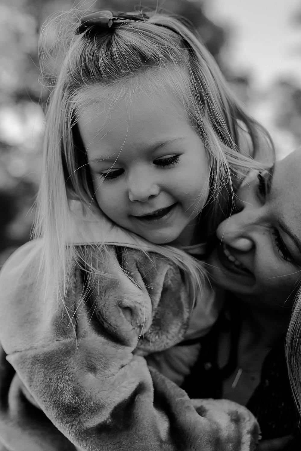 black and white close up photos of mom and daughter in central park nyc. photo by nyc family photographer krystil mcdowall