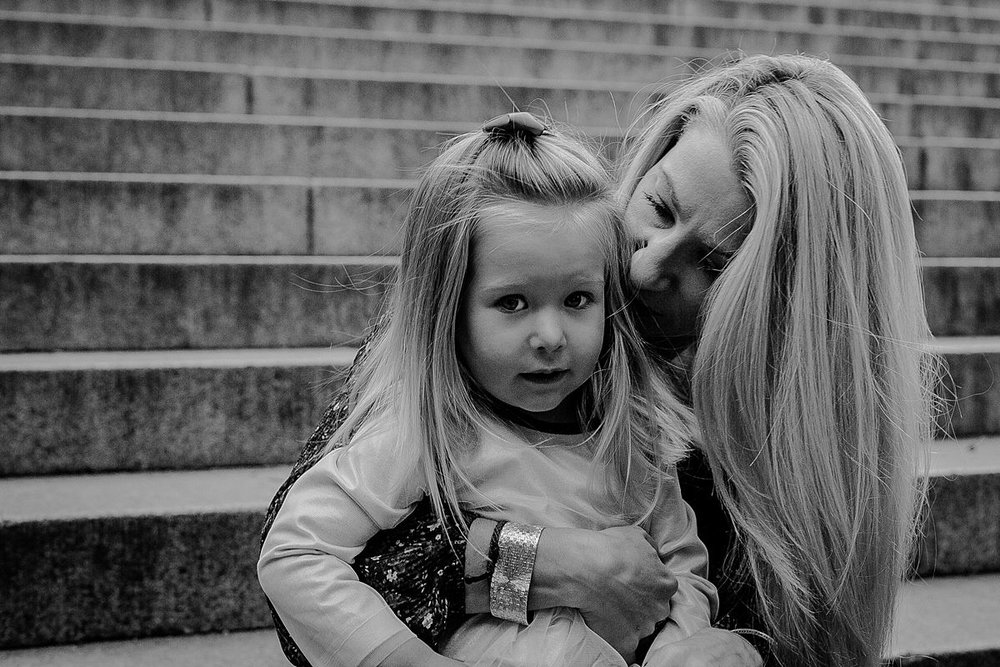mom and daughter playing on steps at bethesda terrace nyc. image by krystil mcdowall photography