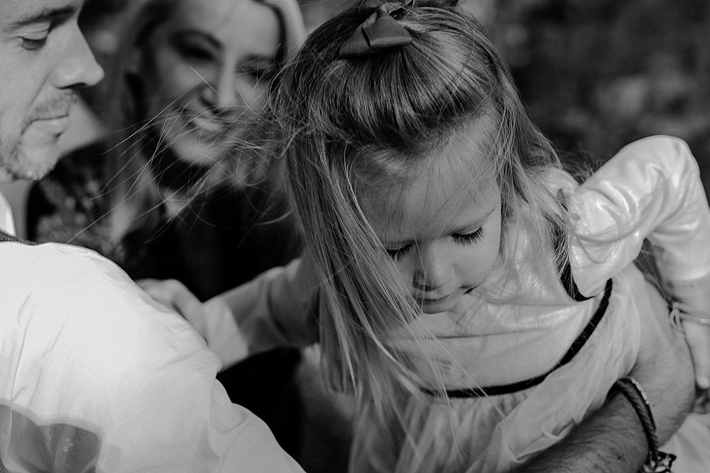 candid image of daughter and her beautiful blonde hair trailing behind her. image by krystil mcdowall photography