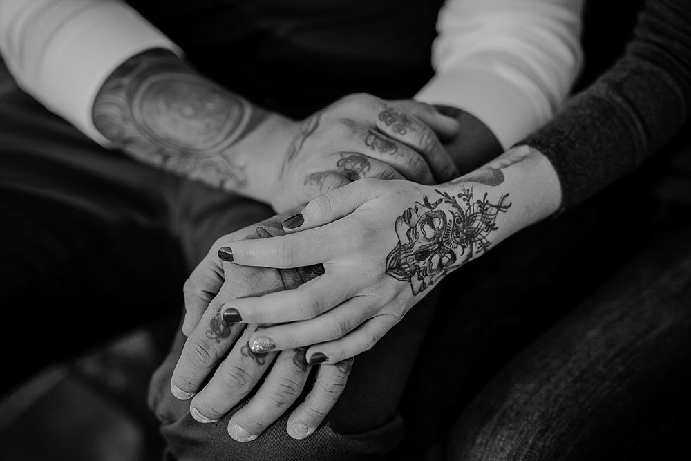 detail shot of couples interlocking hands both with gorgeous tattoos on arms and hands. photo by krystil mcdowall photography
