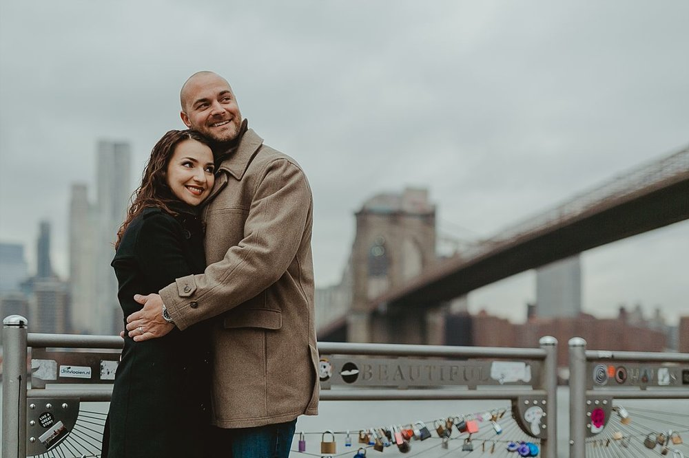 couples photo of husband and wife with brooklyn bridge in the background. image by krystil mcdowall photography