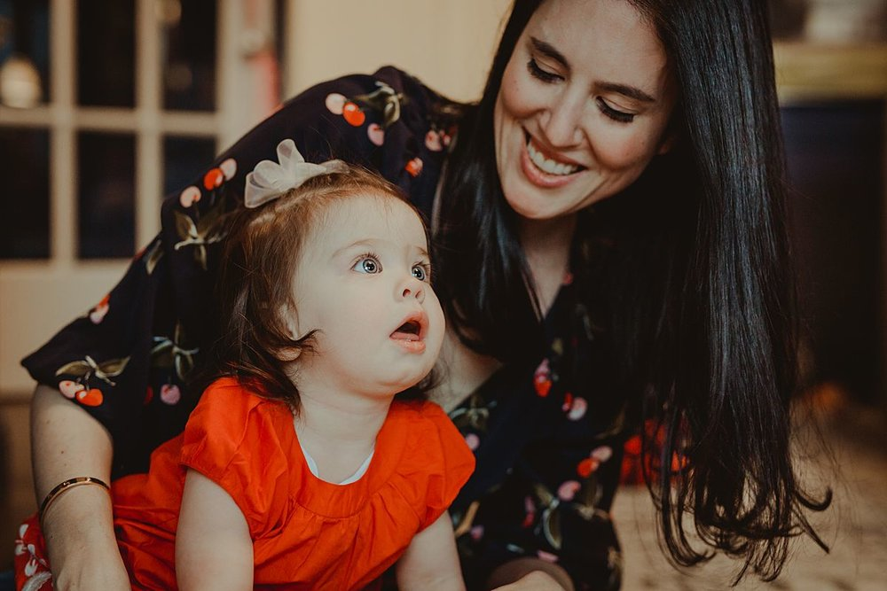 candid portrait of mom and her one year old daughter playing together. photo by nyc family and newborn photographer Krystil McDowall