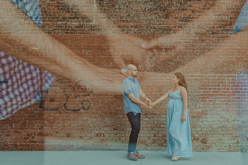double exposure image of couple taken during outdoor maternity photo session. photo by orange county family photographer krystil mcdowall