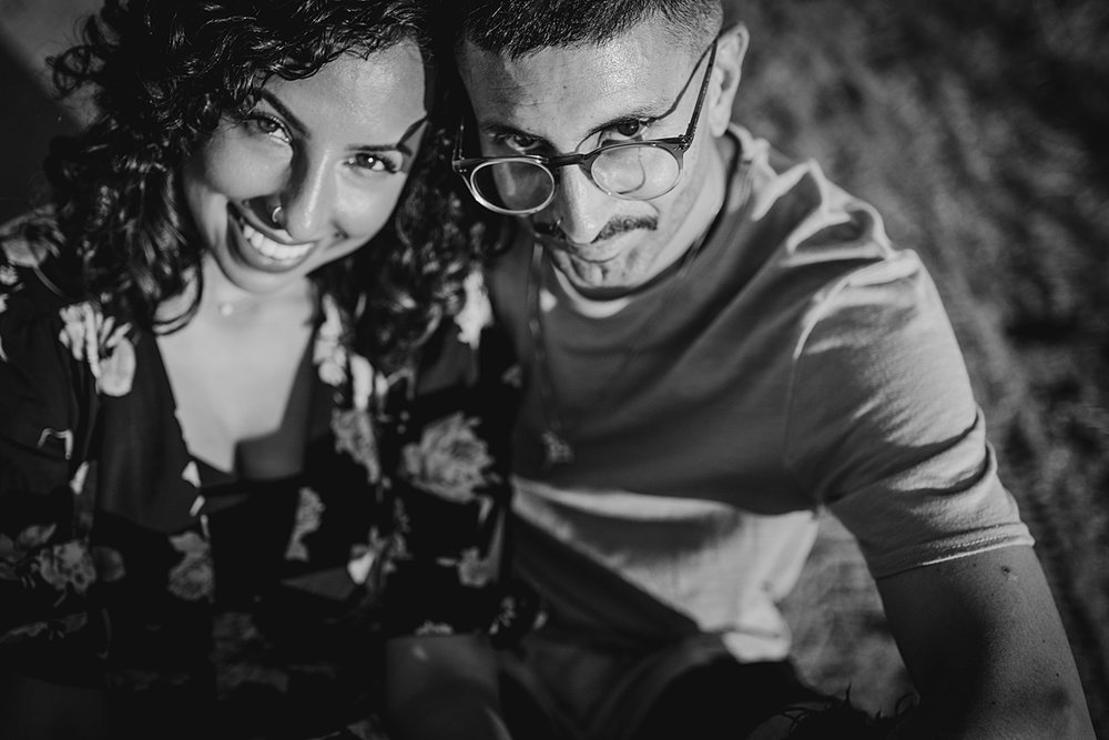 Orange County family photographer. close up black and white photo of couple sitting dirt road at sunset at Irvine Regional Park Orange County