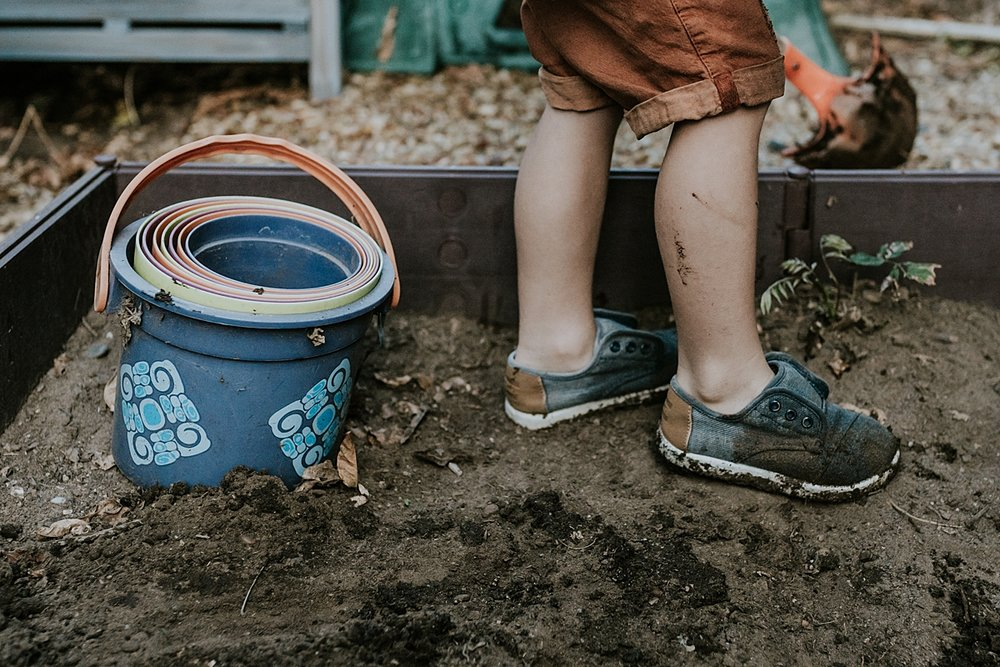 Orange County family photographer. Photo of boy's feet and his rainbow buckets during documentary photo session with Krystil McDowall Photography
