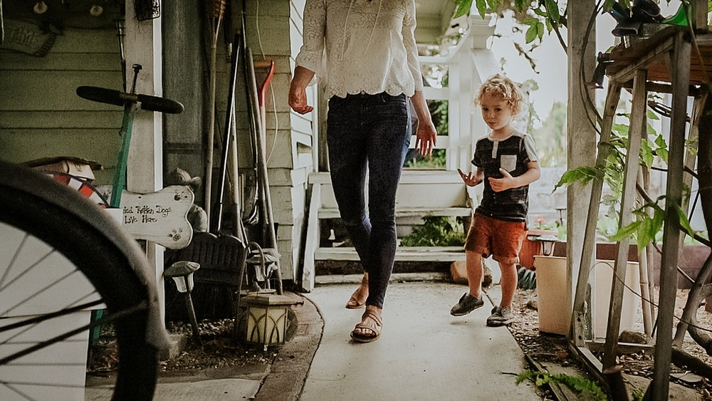 Orange County family photographer. Photo of mom and son after finishing gardening