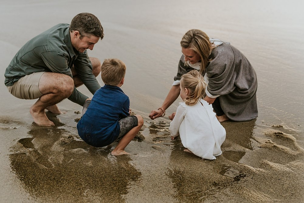 Orange County family photographer. Family plays in the wet sand at Table Rock Beach Laguna Beach during photo session with Krystil McDowall Photography