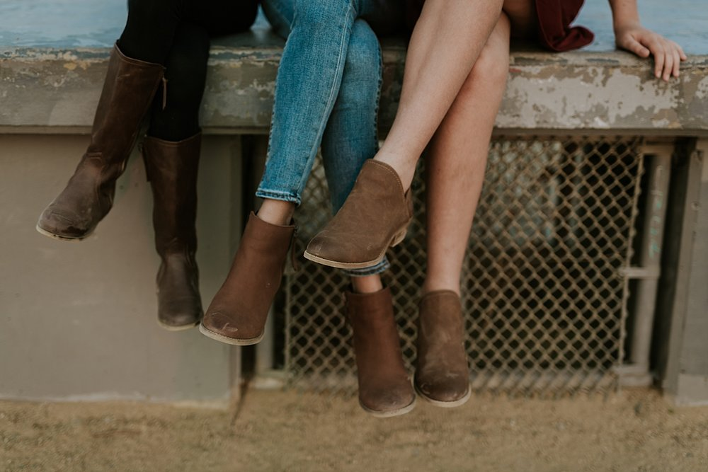 Orange County family photographer. Photo of fall boots worn by mom and her two daughters at a family photo session at Top of the World Laguna Beach