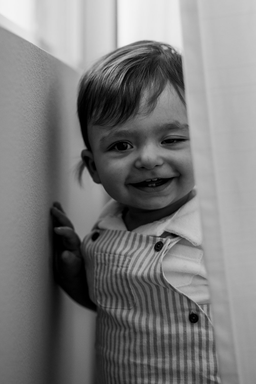 Orange County family photographer. Portrait of one year old at his bedroom window during in home session in Irvine CA