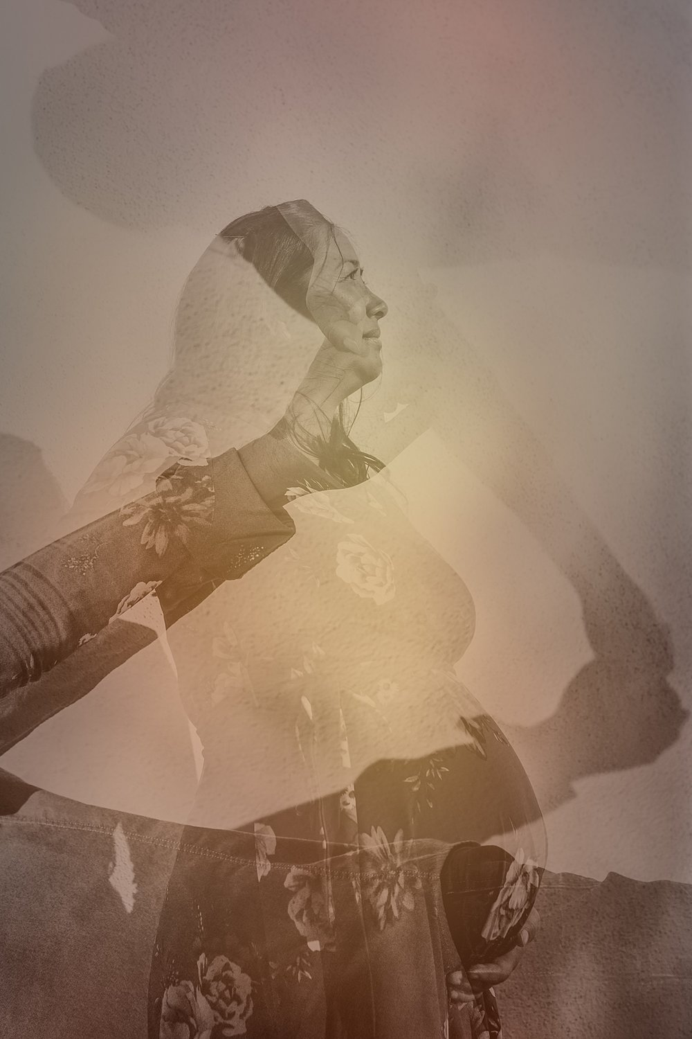 Orange County family photographer. Multiple exposure photo of pregnant mother to be holding her beautiful pregnant belly during maternity photo shoot at Noguchi Garden Costa Mesa