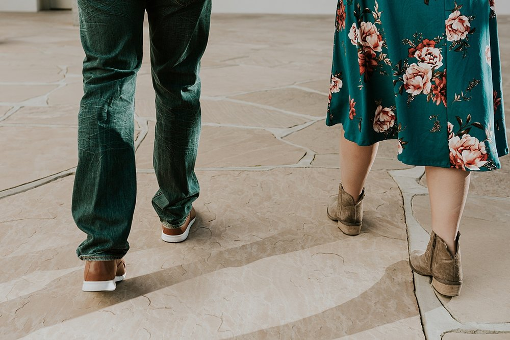 Orange County family photographer. photo of married couple's feet as they walk during maternity photo shoot at Noguchi Garden Costa Mesa