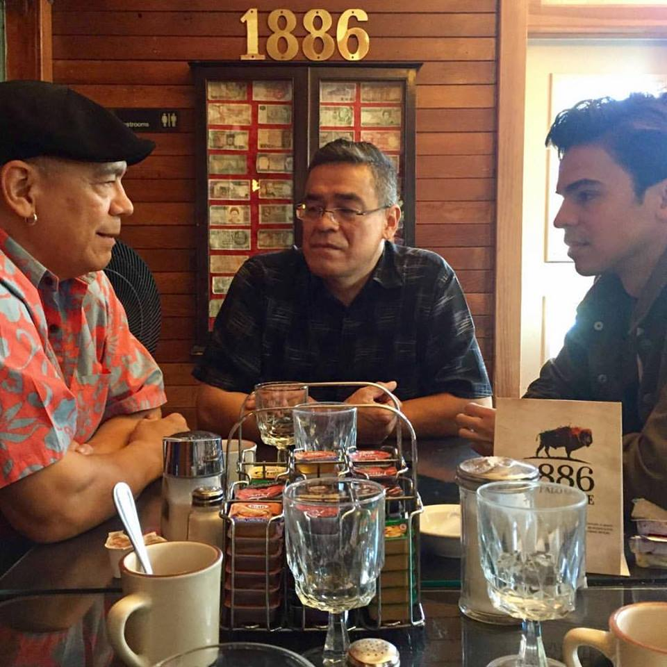 Hunter with his father Lewis, and uncle Lorne, sharing stories.