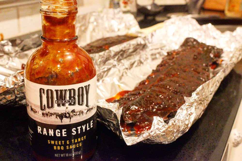 Cowboy Charcoal Sweet & Tangy BBQ Sauce with the Ribs.