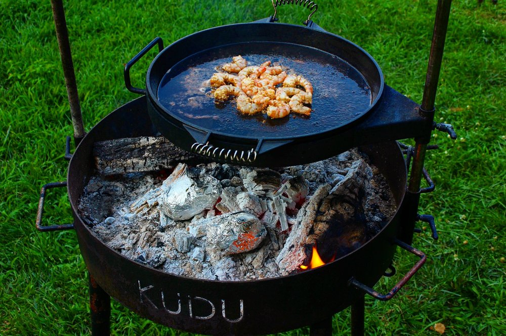 Cooking the shrimp over the fire.