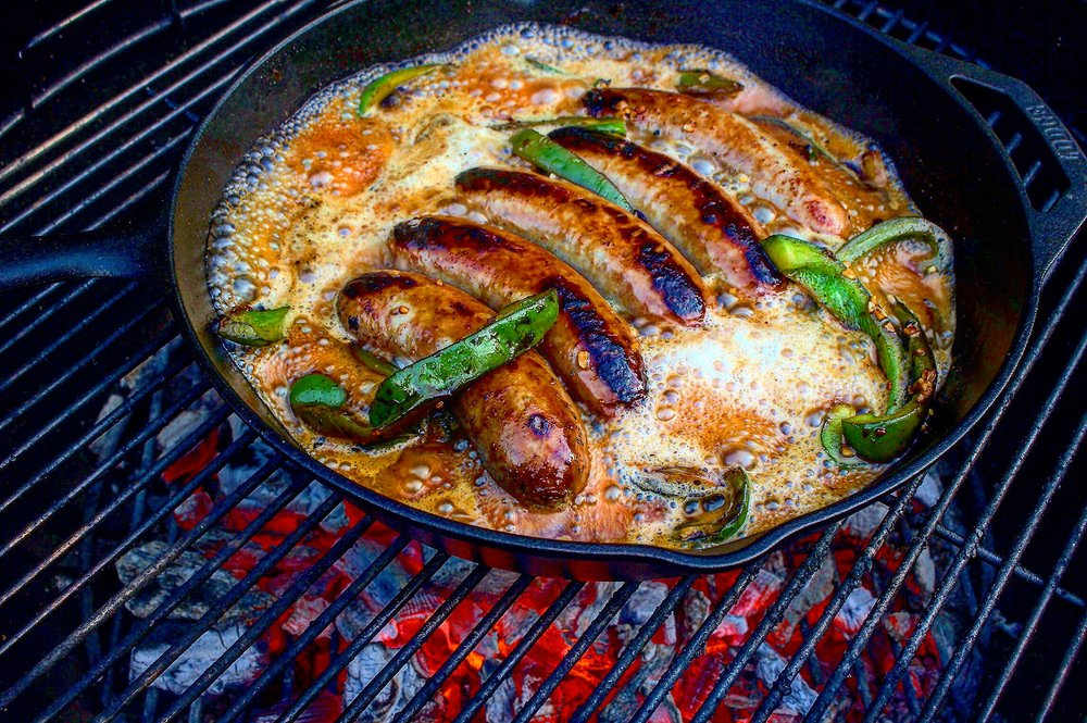 The brats sizzling in the cast iron!