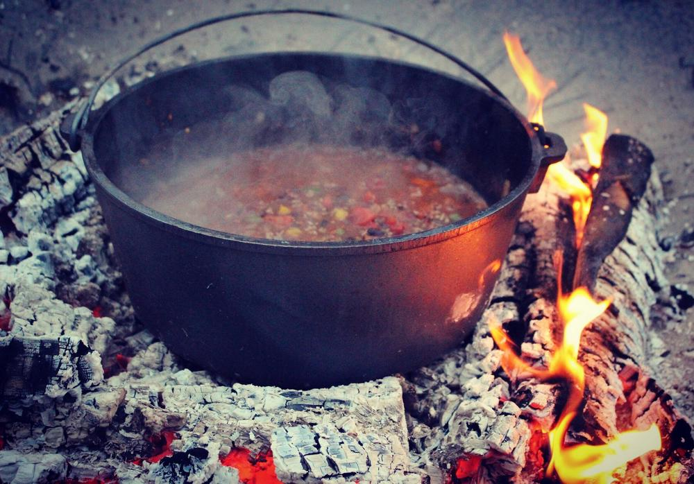 Campfire chili cooking on the coals.