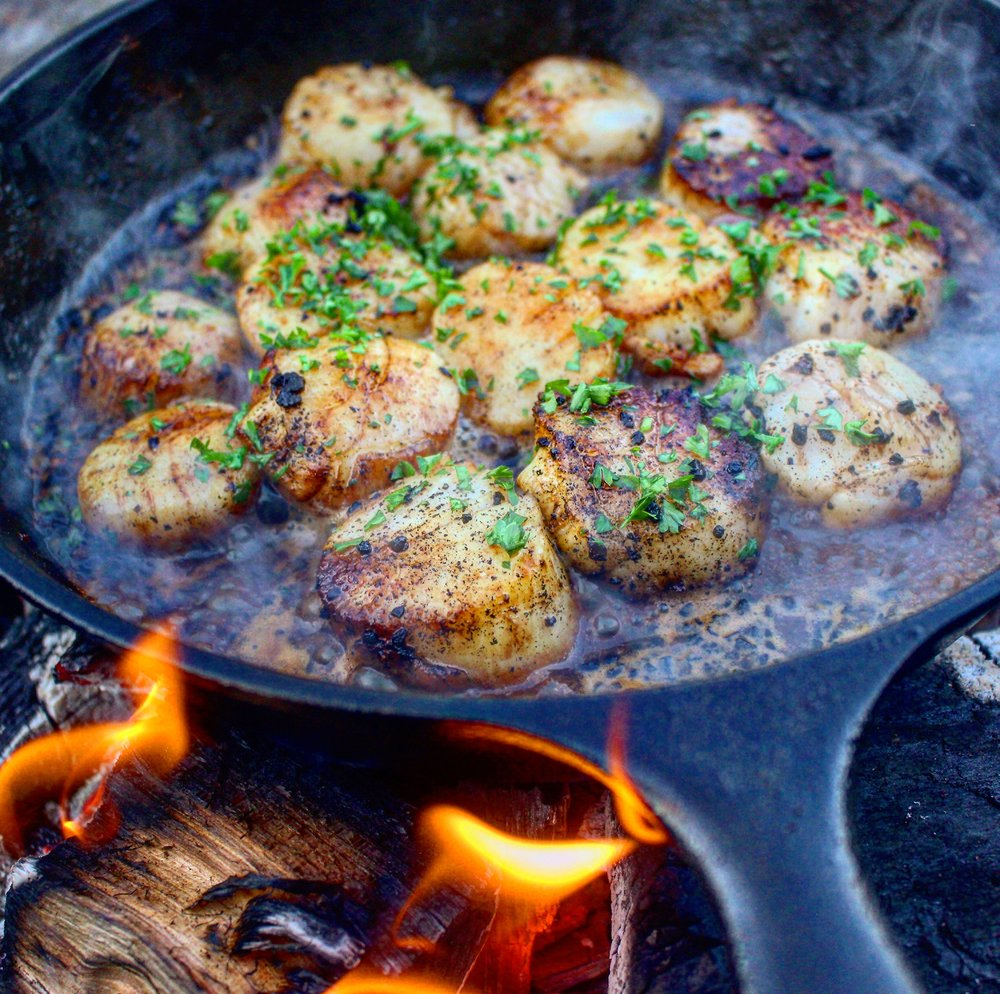 The scallops sizzling in some beer!