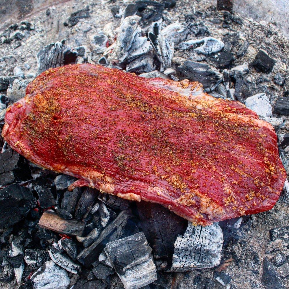 Flank steak on the coals!