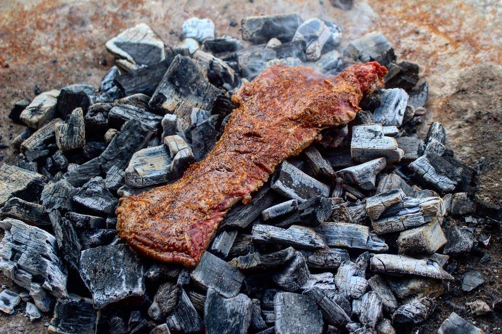 Skirt steak on the coals.
