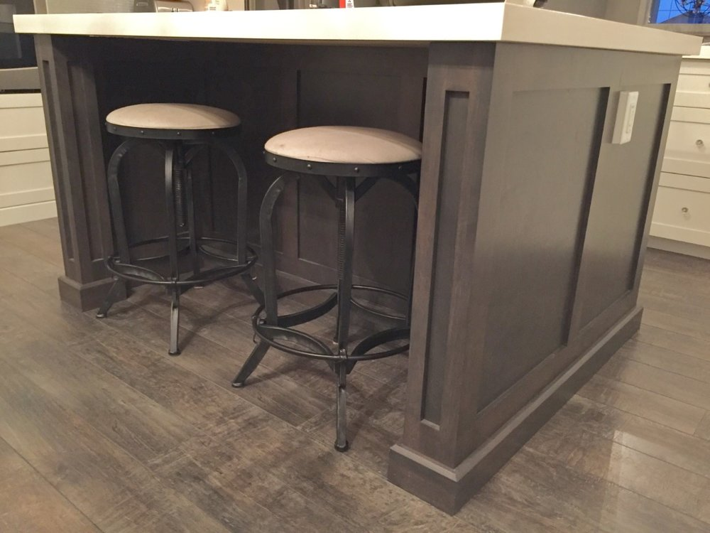 Custom paneled kitchen island