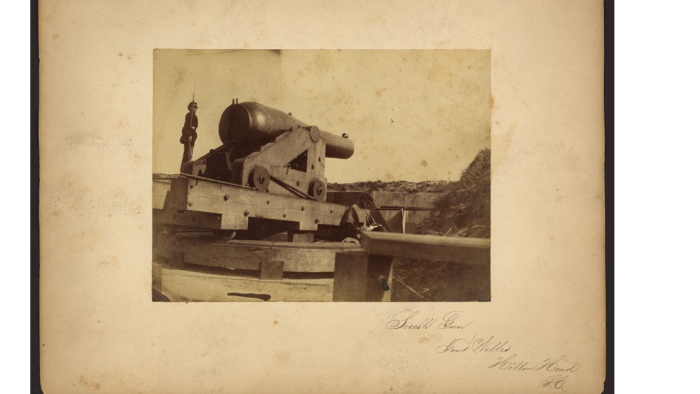 Secesh Gun, Fort Welles [i.e., Wells], Hilton Head, S.C.  Photograph shows a cannon at Fort Wells, two Union soldiers appear to the left and right of the gun. (Moore, Henry P., 1833-1911, photographer)   https://www.loc.gov/item/2010651635/