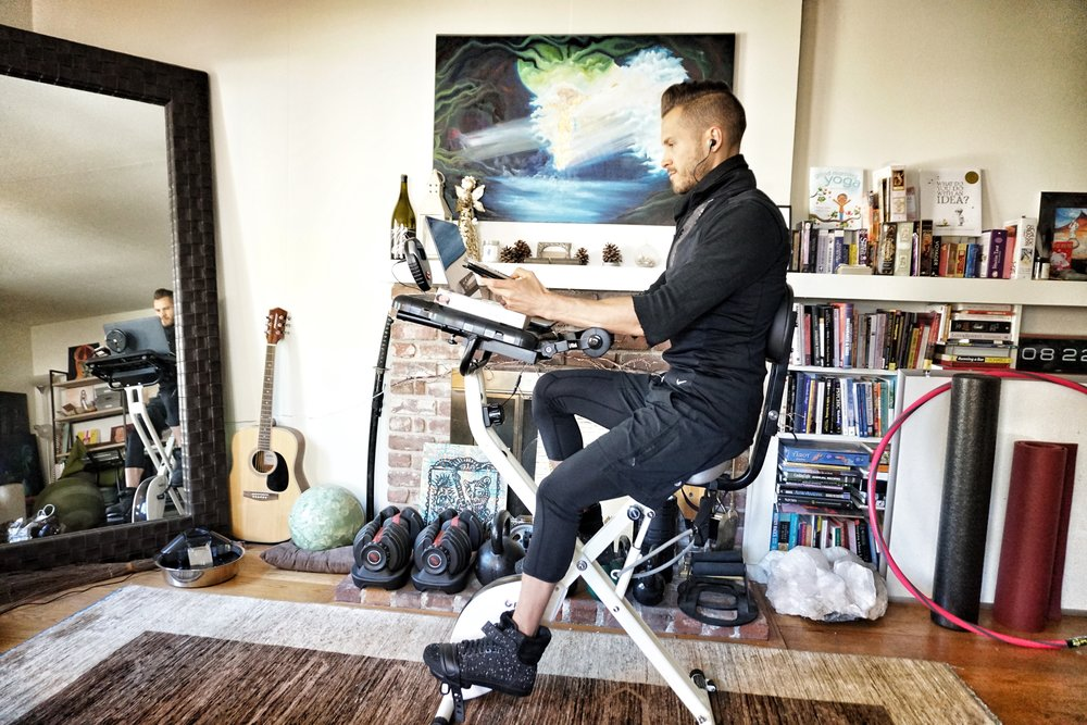 Here I am on my  FitDesk  doing the final edits of this article.   🤓🚴🏼💻  #habitstacking    Shoes by  Android Homme  | Painting by  Carly Lyn Wise