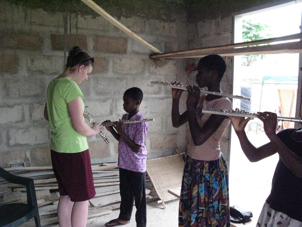 Isabelle, on flute, working with Nunya Students