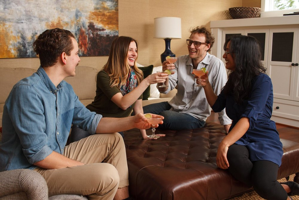 Lifestyle photo example: group of people enjoying cocktails.