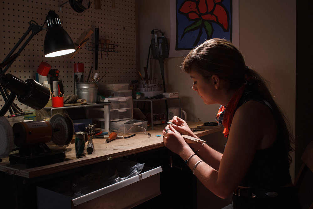 Environmental photo example: metalsmith making jewelry.