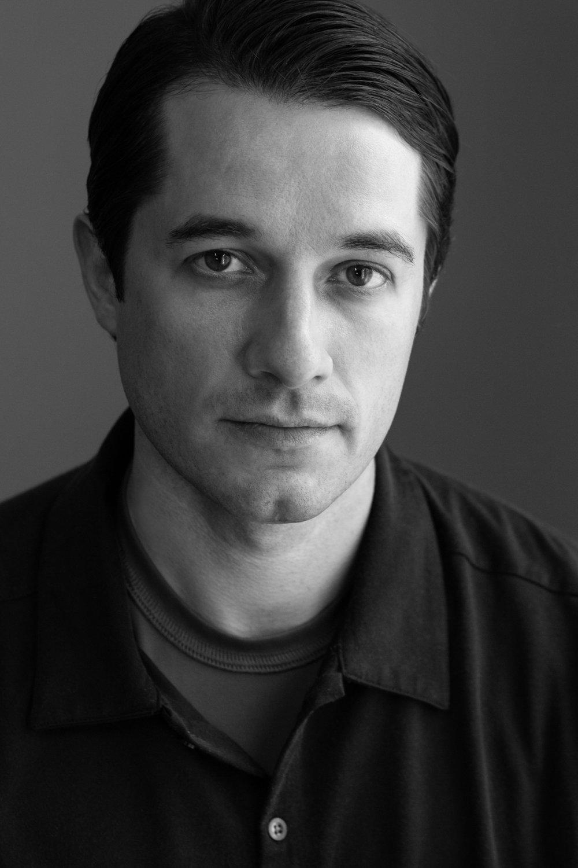 Headshot portrait of Tony
