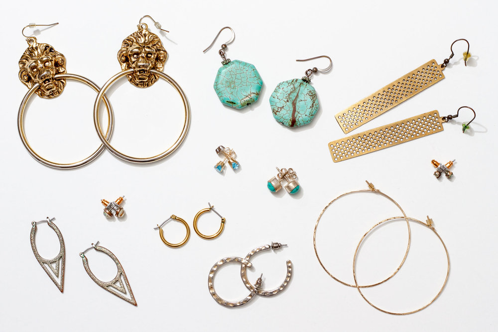 Jewelry options for professional headshots: from simple to statement earrings.