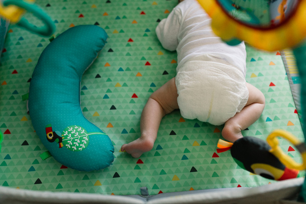 Newborn Laying in Baby Gym During Documentary Session Orlando.jpg